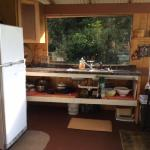full kitchen with propane refrigerator, hot and cold running water, 2 burner cook stove (propane). plenty of dishes, pots & pans.