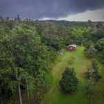 aerial shot of the road up to halela solar home off the grid in the ohia forest